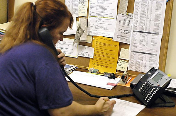 Record-Eagle/Lisa Perkins<br /> Volunteer Kate Dale answers calls to Northwest Michigan Community Action Agency from community members looking for assistance in paying utility bills, foreclosure prevention counselling and food programs.