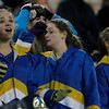 Record-Eagle/Jan-Michael Stump<br /> Traverse City St. Francis color guard members from left, Emily Nelson, Kara Jarvis and Molly Siler react near the end of Saturday's 14-3 loss to Saginaw Nouvel in the state semifinal game in Mount Pleasant.