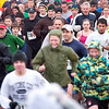 Record-Eagle/Jan-Michael Stump<br /> Nearly 1,000 runners and walkers participated in Thursday's 2nd Annual Turkey Trot in Traverse City, despite a chilly rain.