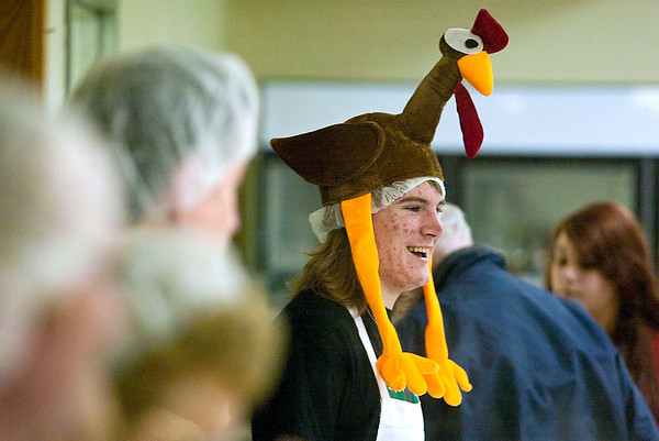 Record-Eagle/Jan-Michael Stump<br /> Scott McClintock wears a turkey hat while serving Thanksgiving meals with other volunteers at VFW Post 2780 on Thursday afternoon.