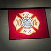 Record-Eagle/Jan-Michael Stump<br /> A flag given to the department by the New York fire department after a Sept. 11 program sits prominently in the lounge of Traverse City Fire Department's Station 2.