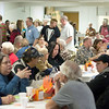 Record-Eagle/Jan-Michael Stump<br /> Volunteers serve a record number of Thanksgiving dinners at Trinity Lutheran Church's community meals program Thursday.