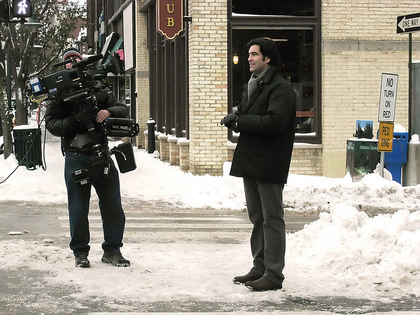 "Carter Oosterhouse films a scene for ""Carter Comes Home"" in front of Traverse City's downtown Christmas tree in December 2008."