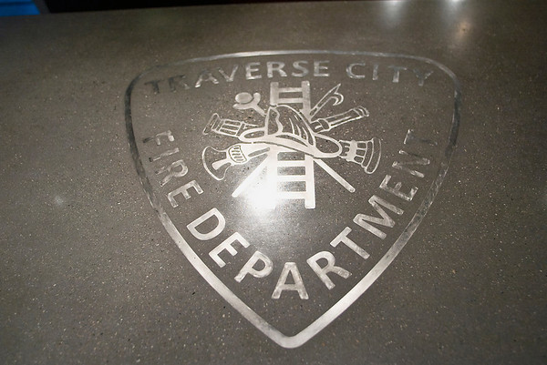 Record-Eagle/Jan-Michael Stump<br /> A concrete countertop in Station 2's kitchen contains the Traverse City Fire Department patch in stainless steel.