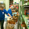 Record-Eagle/Jan-Michael Stump<br /> From left, Lois MacGregor, Joyce McManus and Steve Bemis put together Thanksgiving meal packages at the Father Fred Foundation on Wednesday morning.