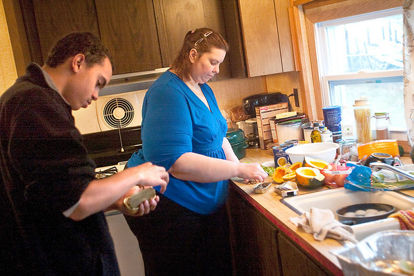 Record-Eagle/Jan-Michael Stump<br /> Julie Compeau and her son Jared, 15, prepare their Thanksgiving dinner in their home on Thursday morning.