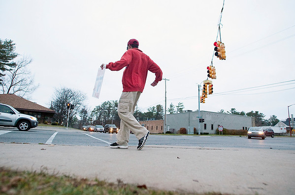 """Record-Eagle/Jan-Michael Stump<br /> Jacob Shonk dances at the intersection of Front Street and Garfield Avenue on Monday afternoon. Shonk has been dancing to promote Domino's Pizza specials 5 days a week, three hours a day, for about 2 years, but said he's been dancing since he was 5. """"The Lord gives us gifts..."""" he said, """"you're supposed to share them."""" Shonk keeps the music he listens to on his headphones a secret."""