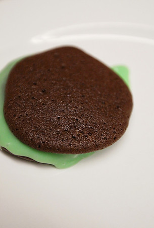 Record-Eagle/Keith King<br /> A chocolate mint sandwich cookie lies on a plate while more are made by Susan Bays, of Traverse City, in the Unity Church kitchen Tuesday, November 22, 2011 for the Unity Church Holiday Cookie Sale December 3, 2011 at the Old Town Playhouse.