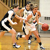 Record-Eagle/Jan-Michael Stump<br /> Traverse City St. Francis' Cassie Williams (10) runs up the court after stealing the ball from Glen Lake's Maddy Brown (21) in the first quarter of Wednesday's game.