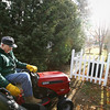 "Record-Eagle/Keith King<br /> Andy Lundberg, of Traverse City, and a World War II veteran who retired after 28 years with the United States Navy, rakes leaves in his yard Tuesday, November 29, 2011 prior to using his riding lawnmower to pick them up in his yard. ""It was cold out so I went in to get my mittens,"" Lundberg said. ""The wind doesn't help,"" Lundberg said, after seeing leaves he'd raked blowing toward his neighbor's house. ""I thought that was the last time,"" Lundberg said after he recalls raking leaves, for what he thought was the last time, before a recent snowfall."