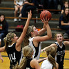 Record-Eagle/Jan-Michael Stump<br /> Glen Lake's Scotlyn Brengman (14) tries to stop Traverse City St. Francis' Liza Erickson(44) on her way to a layup in the second half of Wednesday's game.
