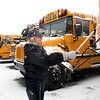 Record-Eagle/Douglas Tesner<br /> Sandra Nesky cleans snow off her bus off after hearing Suttons Bay Public Schools is in preliminary talks with Bay Area Transportation Authority about busing students to school. Nesky has been driving for seven years.