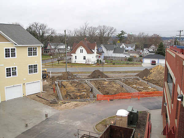 Record-Eagle/Bill O'Brien<br /> More housing is under construction at State Street Commons in Traverse City, where developers recently pulled permits on another $800,000-plus at the project by Socks Construction.