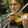 Record-Eagle/Lisa Perkins<br /> Cindy Nichols played traditional Celtic tunes on her fiddle during the St. Andrews Society of Northwestern Michigan's gathering to celebrate the birthday of the patron Saint of Scotland.