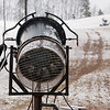 Record-Eagle/Douglas Tesner<br /> Tray Posavatz adjusts a snow gun at Mt. Holiday Ski and Recreation Area. Resort operators hope to be open on Dec. 11.