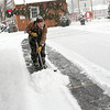 "Record-Eagle/Douglas Tesner<br /> Josh Zak tries to keep up with the falling snow as he shovels it in the parking lot of the Komrska Tree Farms lot on 14th street in Traverse City.  ""It's a good way to keep warm,"" said Zak."
