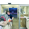 Record-Eagle/Jan-Michael Stump<br /> Peter Edgley brings in donated items at Goodwill Industries of Northern Michigan Monday night. They are now accepting donations such as new toys and clothes for their Holiday Needs Program, which will give them to families in need for the holidays.