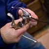 Record-Eagle/Jan-Michael Stump<br /> Don Cunkle repairs a bike.