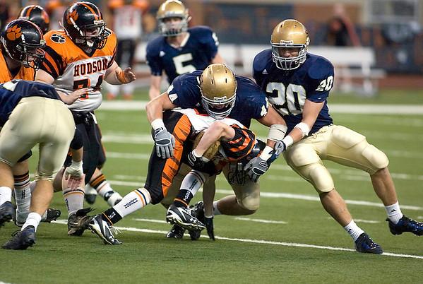 Record-Eagle/Jan-Michael Stump<br /> Gladiators linebacker Max Bullough (44) buries Hudson running back Drew Milligan (22).