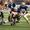 Record-Eagle/Jan-Michael Stump<br /> Gladiators linebacker Max Bullough (44) buries Hudson running back Drew Milligan (22).
