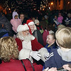 Record-Eagle/Garret Leiva<br /> Santa Claus lights up downtown Traverse City Friday evening during the annual community Christmas tree lighting ceremony. The tree, a blue spruce from the Long Lake Township Hall, stands approximately 40 feet tall. Santa received a key to the city from Traverse City Mayor Pro-Tem, Ralph Soffredine along with a serenade of holiday songs from members of the Sweet Adelines. Santa also visited with children at his holiday house at the corner of Cass and East Front street.