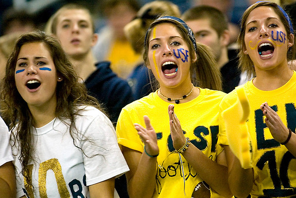 Record-Eagle/Jan-Michael Stump<br /> Traverse City St. Francis fans, from left, Jessica Heger, Alexandra Michelin and Erika Michelin cheer during the Gladiator's win over Hudson in Saturday's state final in Detroit.