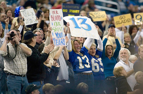 Record-Eagle/Jan-Michael Stump<br /> Traverse City St. Francis fans cheer after a touchdown against Hudson in Saturday's state final.