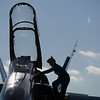Record-Eagle/Jan-Michael Stump<br /> Lt. Amy Tomlinson climbs out of the Navy F/A-18 Hornet as she and fellow Blue Angels crew member Lt. C.J. Simonsen arrive at U.S. Coast Guard Air Station Traverse City Tuesday. The crew is on an overnight visit to do a safety inspection for their upcoming summer visit, which includes checking things such as air space, maintenance facilities and lodging for the 54 crew members who will visit during the National Cherry Festival.