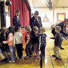 Record-Eagle/Jan-Michael Stump<br /> VFW Post 2780 members, from left, Bob Griffin, Jerry Parrish and Bill Volkening greet Eastern Elementary School students after the school assembly for their Trick or Treat for Troops candy drive Wednesday in the school gym. Kindergarten students announced that 119 pounds of Halloween candy was donated by students and community members, and will be sent to overseas American troops. Last year the school collected 76 pounds of candy.