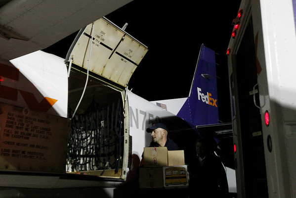 Record-Eagle/Jan-Michael Stump<br /> FedEx courier Tyson Cordell loads packages on a plane at Cherry Capital Airport.