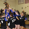 Record-Eagle/James cook<br /> Leland players celebrate after winning the Class D regional Thursday.