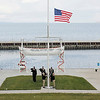 Record-Eagle/Jan-Michael Stump<br /> Griffin Battalion of the U.S. Navy Reserve raises the American Flag at the start of Thursday's 36th annual Great Lakes Mariners Memorial Service Thursday at the Great Lakes Maritime Academy. The service, to remember and honor mariners  who have lost their lives on the Great Lakes and oceans, shares the date with the sinking of the Edmund Fitzgerald, which sank in a 1975 storm on Lake Superior with 29 crew aboard, including Academy cadet David Weiss.