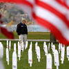 """Record-Eagle/Jan-Michael Stump<br /> Jerry Freels, of Traverse City, reads memorials for members of the military from Michigan killed in Iraq and Afghanistan at a Veterans For Peace Veteran's Day memorial at the Open Space. """"It's an opportunity to show them we care,"""" said Freels."""
