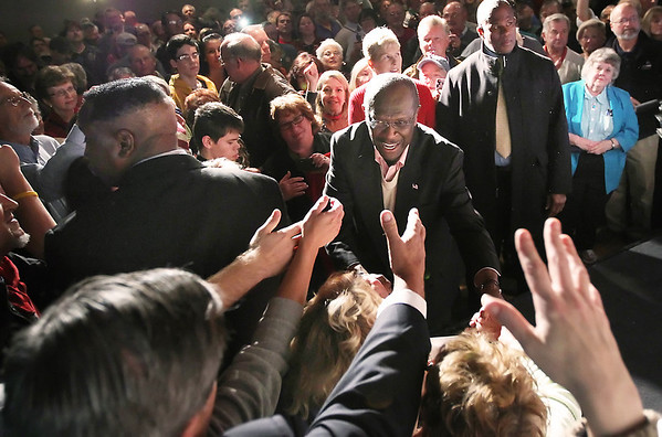 Record-Eagle/Keith King<br /> Republican presidential candidate Herman Cain meets people after his presentation Thursday, November 10, 2011 at Streeters in Traverse City.