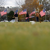"""Record-Eagle/Jan-Michael Stump<br /> Patriot Guard Riders stand with American Flags along Grand View Parkway near Union Street for a Veteran's Day memorial. """"Our town is getting really great about honoring veterans,"""" said Patriot Guard Rider captain John Lefler."""