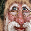 Record-Eagle/Jan-Michael Stump<br /> Diane Avery paints St. Nicholas images on driftwood, like this piece, and other items.