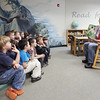 """Record-Eagle/Keith King<br /> Brett Hood reads """"Some Dogs Do"""" to his first grade class Friday in the Lake Ann Elementary School library."""