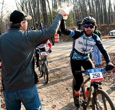 Record-Eagle/Douglas Tesner<br /> Daniel Sterling reaches for a cup of water as he passes a Williamsburg checkpoint.