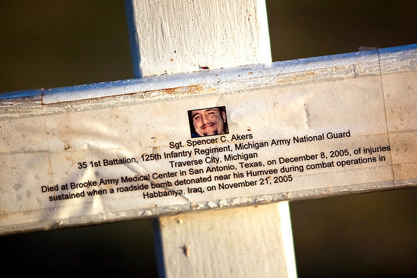 Record-Eagle/Jan-Michael Stump<br /> Sgt Spencer Akers of the Michigan Army National Guard was remembered on one of the 178 crosses placed by members of Veterans for Peace Chapter 50 in memory of those from Michigan who died in the current wars in Iraq and Afghanistan. Akers, of Traverse City, died in November 2005 from injuries sustained in a roadside bomb explosion.