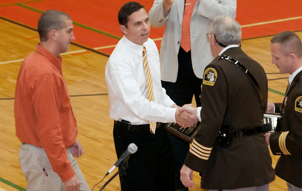 Record-Eagle/Douglas Tesner<br /> Grand Traverse County Sheriff Tom Bensley and undersheriff Nathan Alger presented teacher Matt Schelich, left, and principal, Matt Nausadis, center, with citizen's valor awards during an assembly at Kingsley High School on Friday.