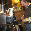 Record-Eagle/Jodee Taylor<br /> French Clements makes a vanilla latte at his restaurant, Frenchies Famous, on Randolph St.