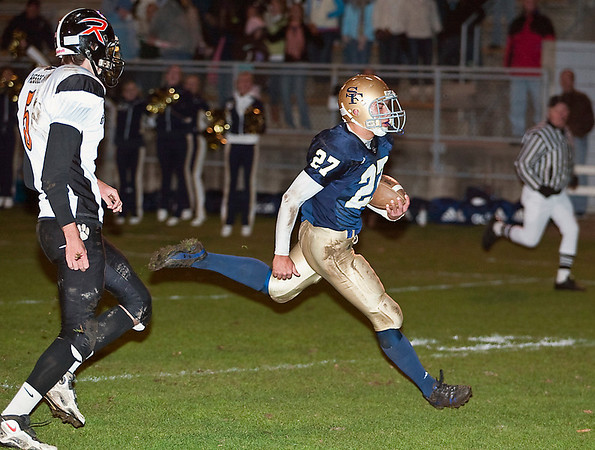 Record-Eagle file photo/Jan-Michael Stump<br /> St. Francis halfback John Zakrzewski (27) runs for a touchdown in last week's win over Rudyard.