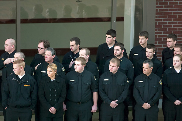 Record-Eagle/Jan-Michael Stump<br /> Great Lakes Maritime Academy cadets stand at attention as the flag is raised to start the 34th Annual Great Lakes Memorial Service Tuesday at the Great Lakes Maritime Academy.
