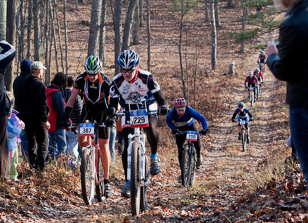 Record-Eagle/Douglas Tesner<br /> Andy Elliott (229), Howard Cricket (387) and Hugh Smallwood (110) Bikers climb a hill during Saturday's Iceman Cometh Challenge Bike Race.