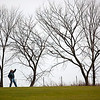 Record-Eagle/Jan-Michael Stump<br /> John Kain, of Suttons Bay, watches his shot on the third hole at Elmbrook Golf Course on Friday afternoon.