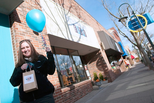 Record-Eagle/Jan-Michael Stump<br /> Balloons like the one held by Colleen Paveglio, marketing director for the DDA/DTCA, will mark the downtown Traverse City businesses participating in Saturday's Shop Your Community Day. Shoppers will be able to choose from a list of participating non-profits to which 15 percent of their purchases will be donated.