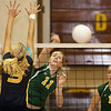 Record-Eagle/Douglas Tesner<br /> TC West's Tayler Rodes (11) goes for a kill against Grand Haven's Mindy Marks Tuesday as teammates Emily Ellison (14) and Courtney Saxton look on.