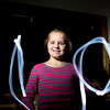 "Record-Eagle/Jan-Michael Stump<br /> Blair Elementary School fifth-grader Irina Chekhovskiy spells out ""10"" with a flashlight. She turns 10 on 10-10-10."
