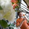 Record-Eagle/Jan-Michael Stump<br /> Floral artist Derek Woodruff works on arrangements for an upcoming wedding in his Floral Underground studio.