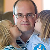 Record-Eagle/Jan-Michael Stump<br /> Greg Harrand receives kisses from his three year-old twin daughters, Elizabeth, left, and Kate.
